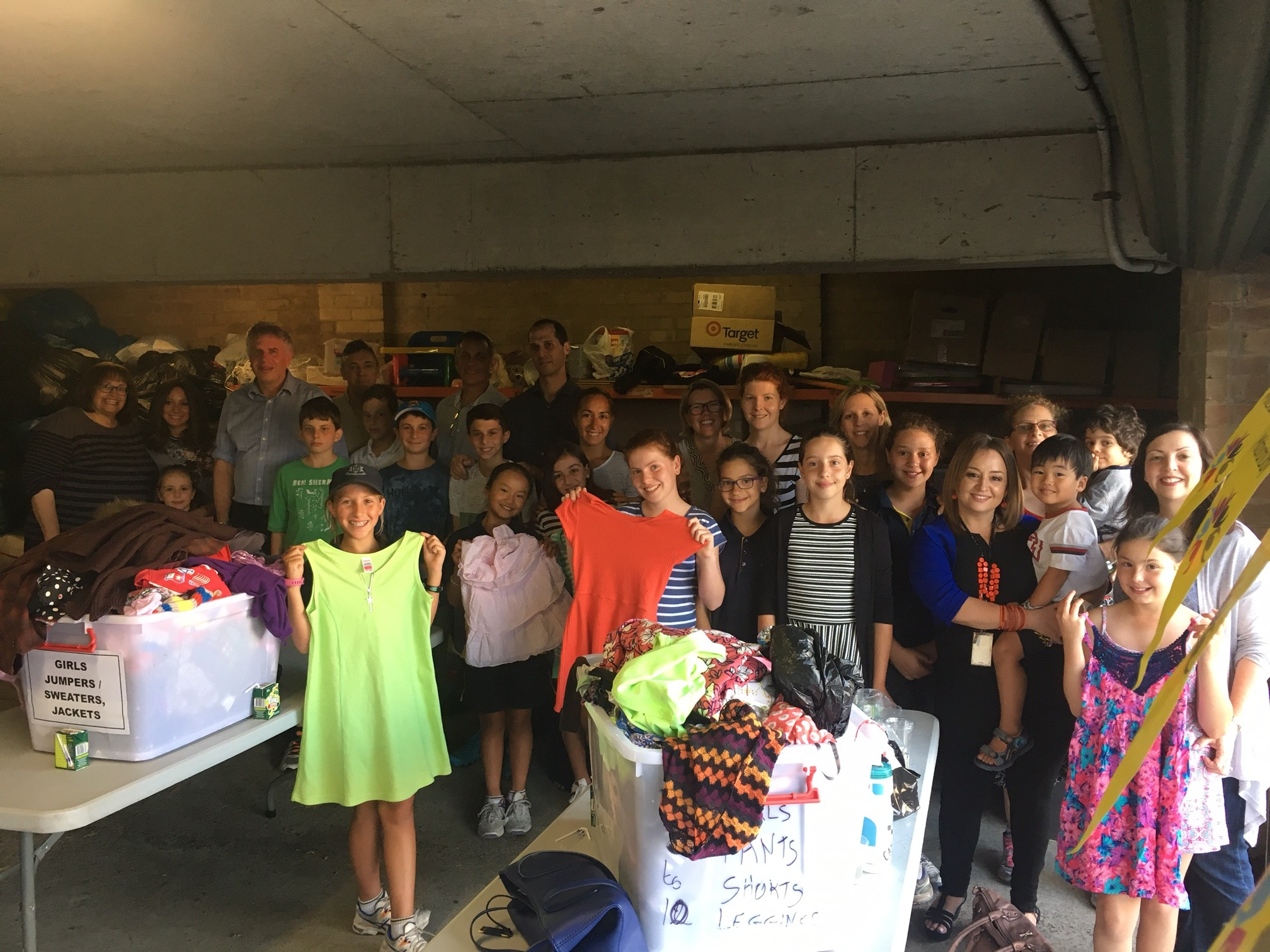 Bar/Bat mitzvah groups visited Mrs Markovits charity garage to sort clothes for the needy